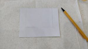 a white card with a square pocket drawn inside the card