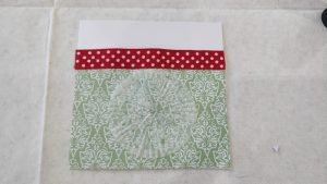 A thin paper snowflake glued onto a decorative paper pocket