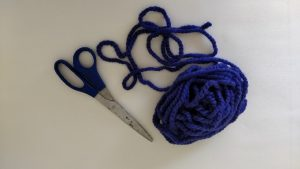 purple yarn and scissors