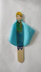 A popsicle stick decorated to look like Elsa from Frozen