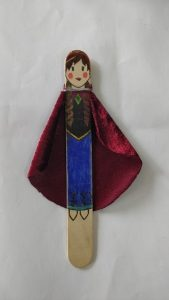 A popsicle stick decorated to look like Princess Anna from Frozen.