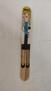 A popsicle stick to look like a doctor
