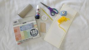 Craft supplies sat on a white fabric cloth