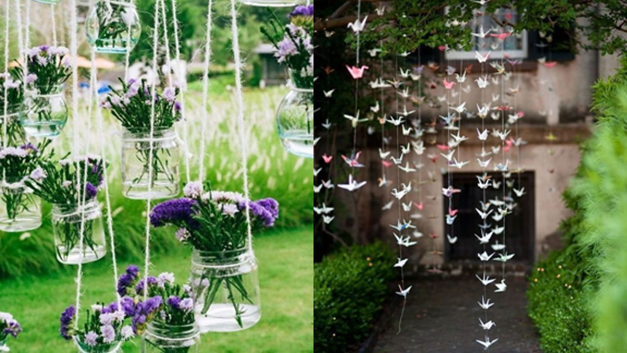 Paper cranes and jars of flowers hanging from tree branches