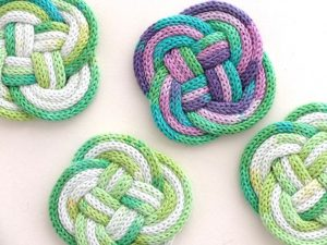 Woven coasters made of french knit tubes.