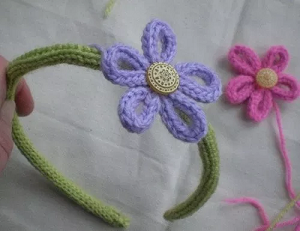 flower headband made from french knitted tubes.