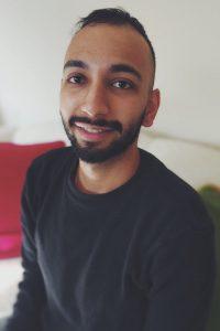 Headshot of Akash smiling